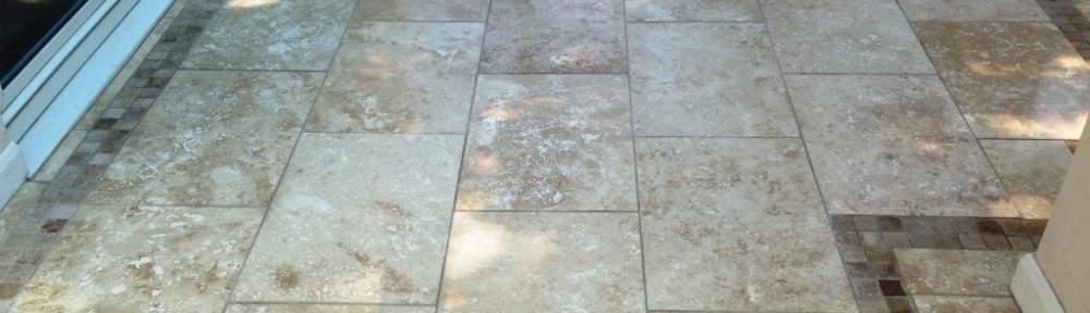 Damaged Travertine Tiled Floor Repaired in Oldham Conservatory