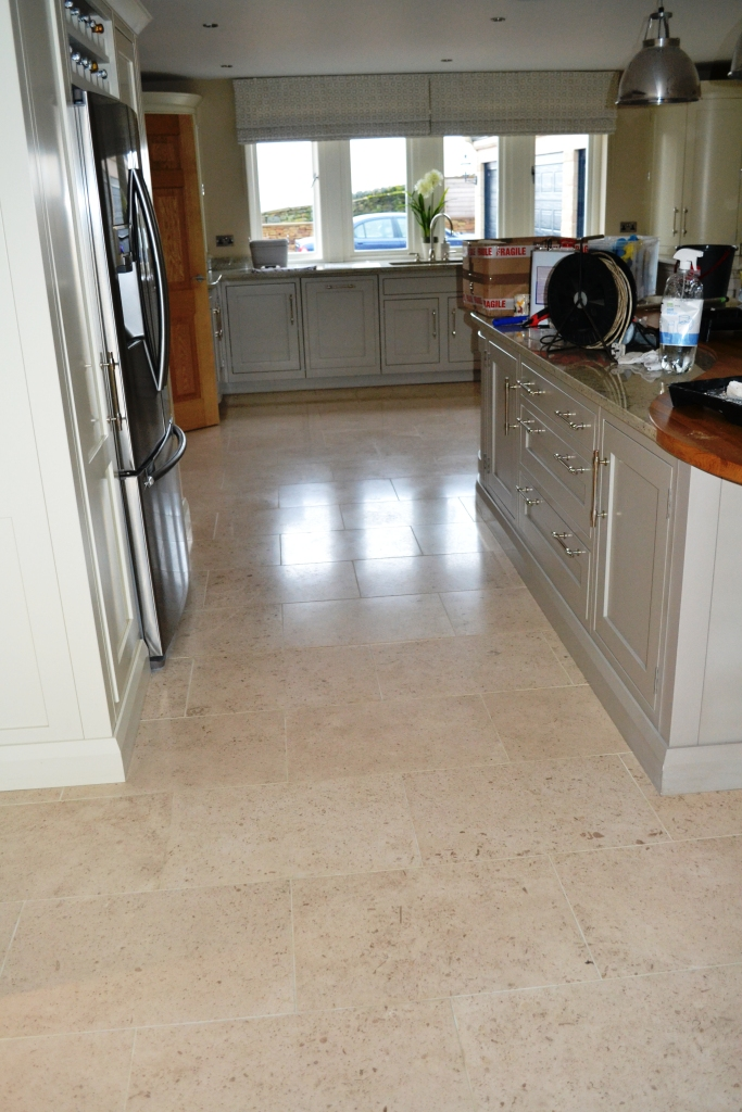 Limestone tiled floor before burnishing Peel Green