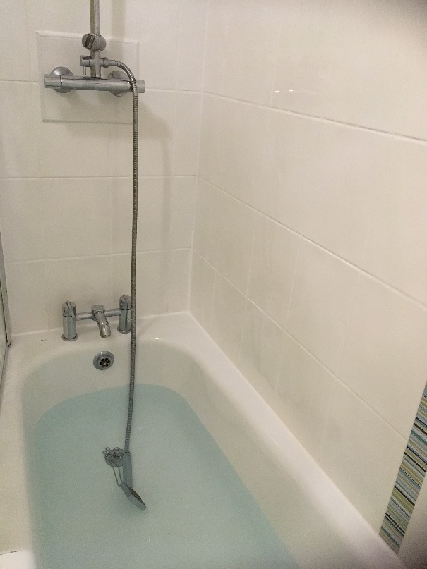 Manchester Rental Apartment Bathroom After Grout Colouring