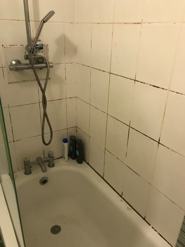 Manchester Rental Apartment Bathroom Before Grout Colouring