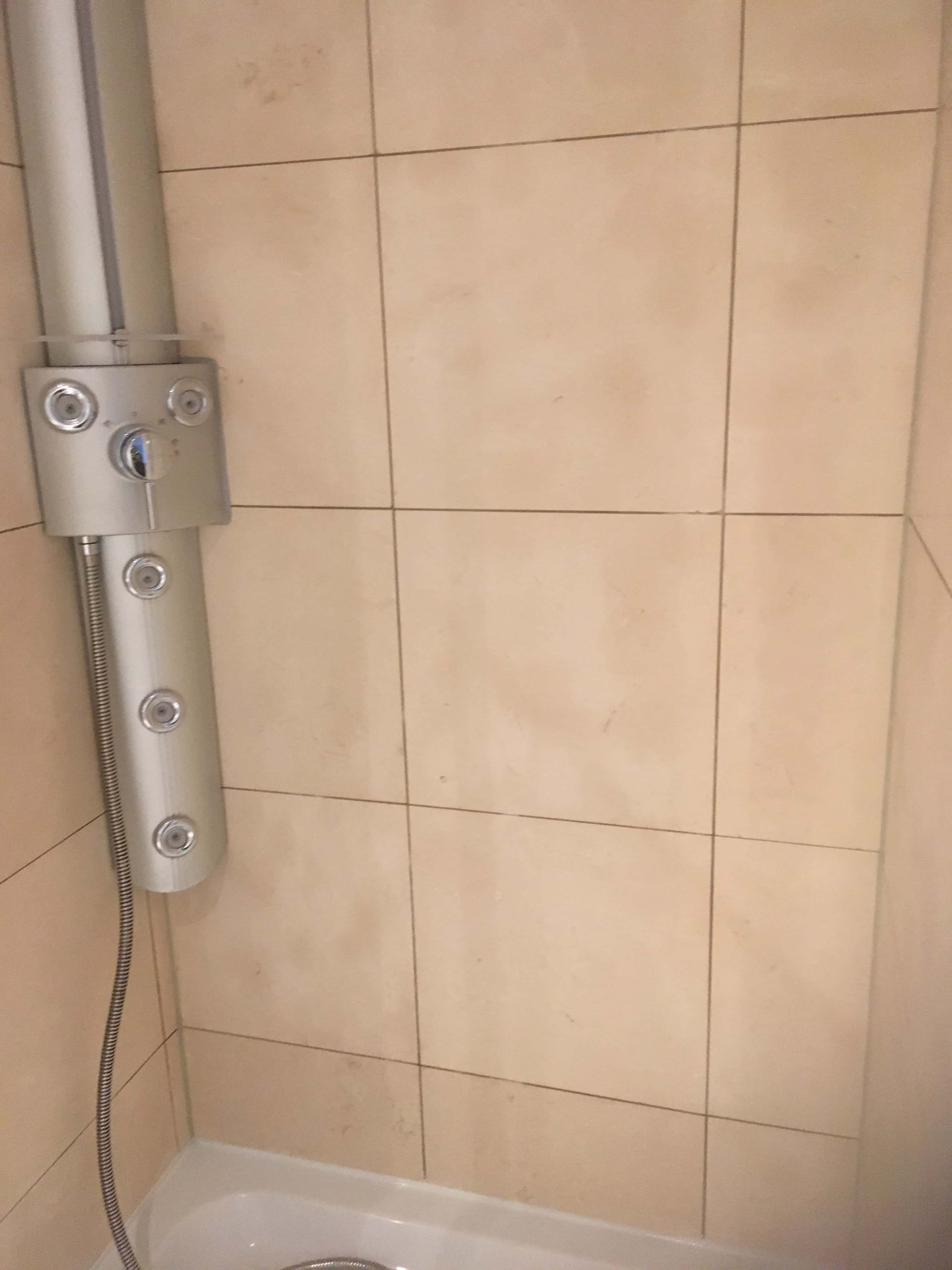 Limestone Tiled Shower Cubicle After Mould Removal Manchester City Centre